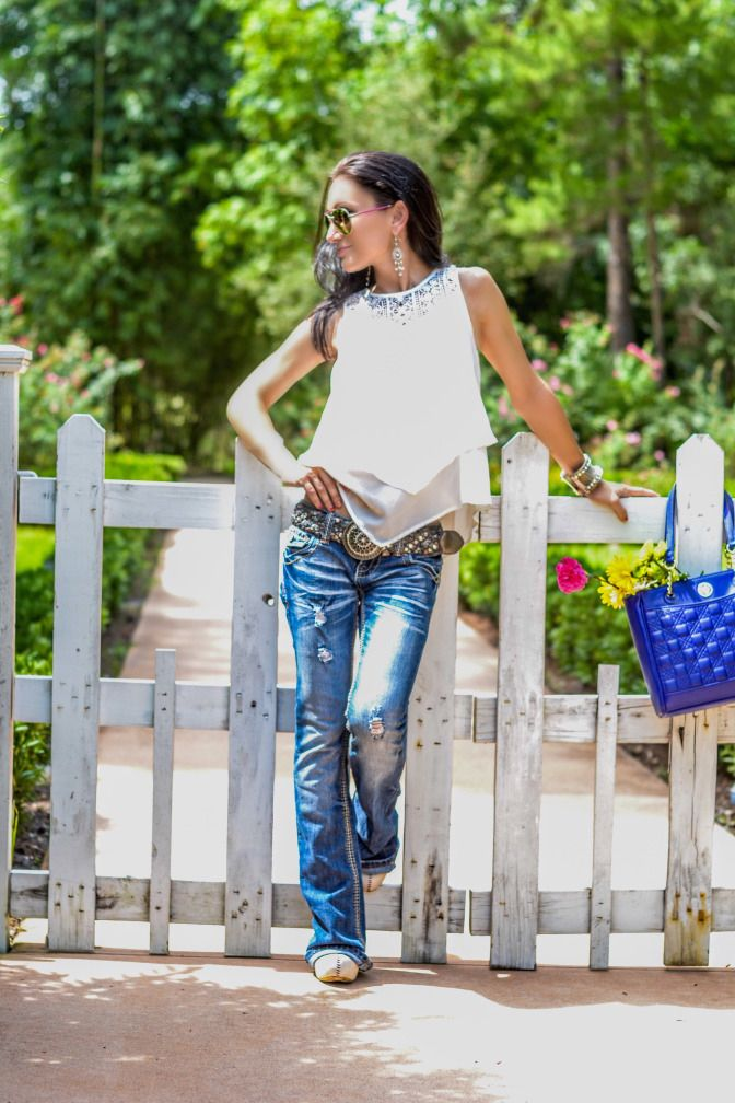 Flare jeans, at the garden. White picket fence