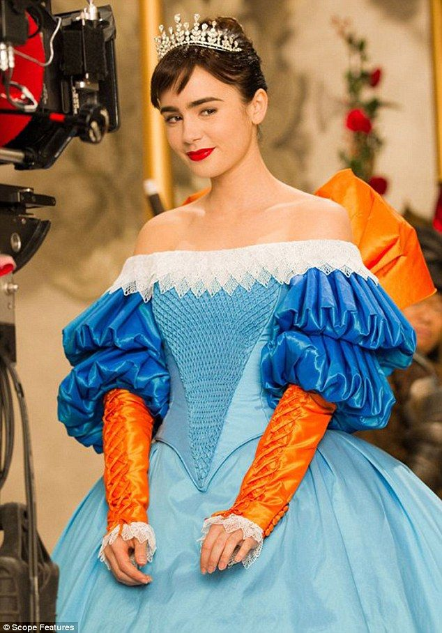 Snow white 39 s blue and orange wedding gown lily collins for Mirror mirror cast