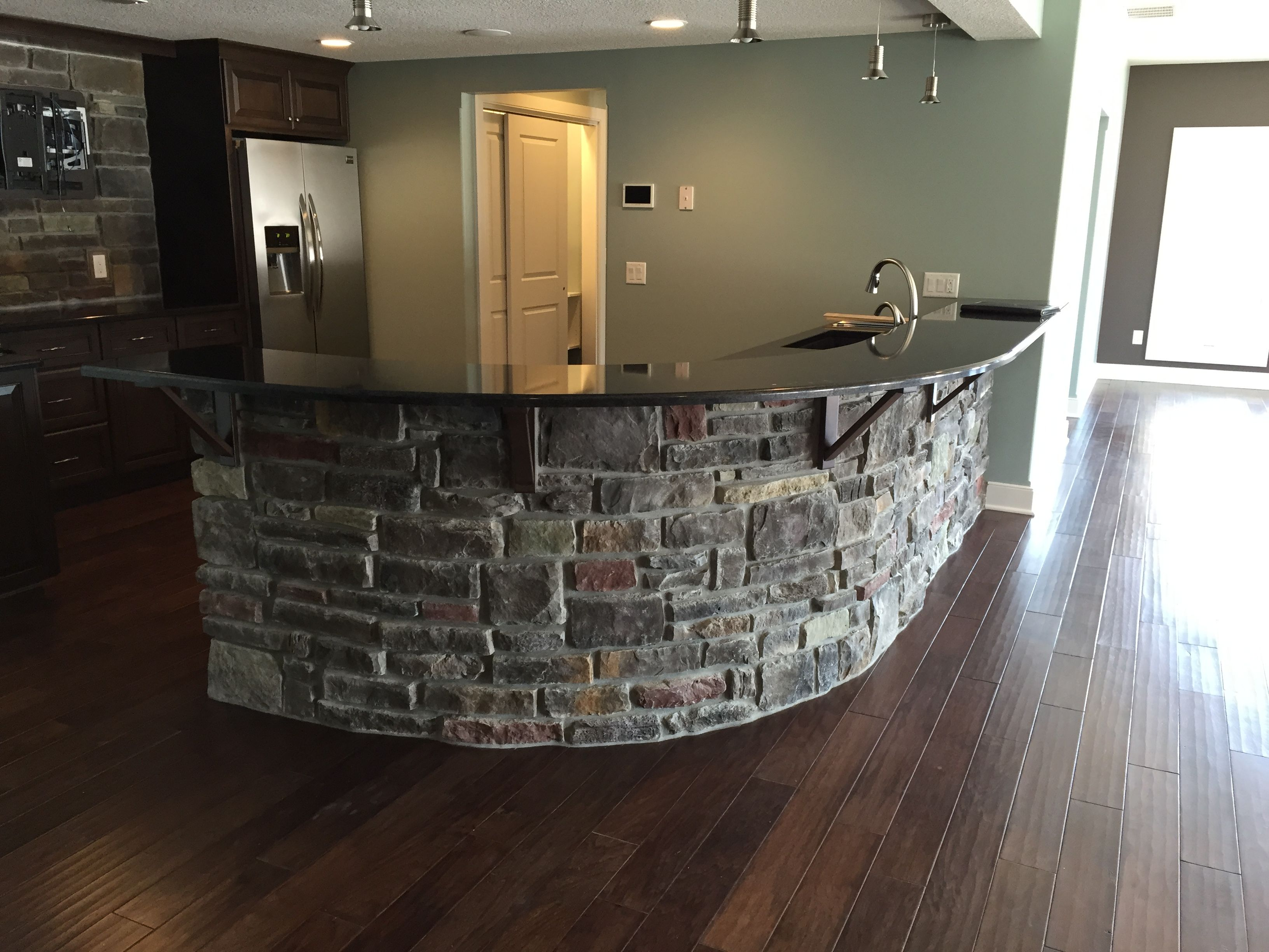 Beautiful Basement Kitchen With Stoned Bar Front. Dakota Cut Cobble And  Laytite Blend. Ju0026N