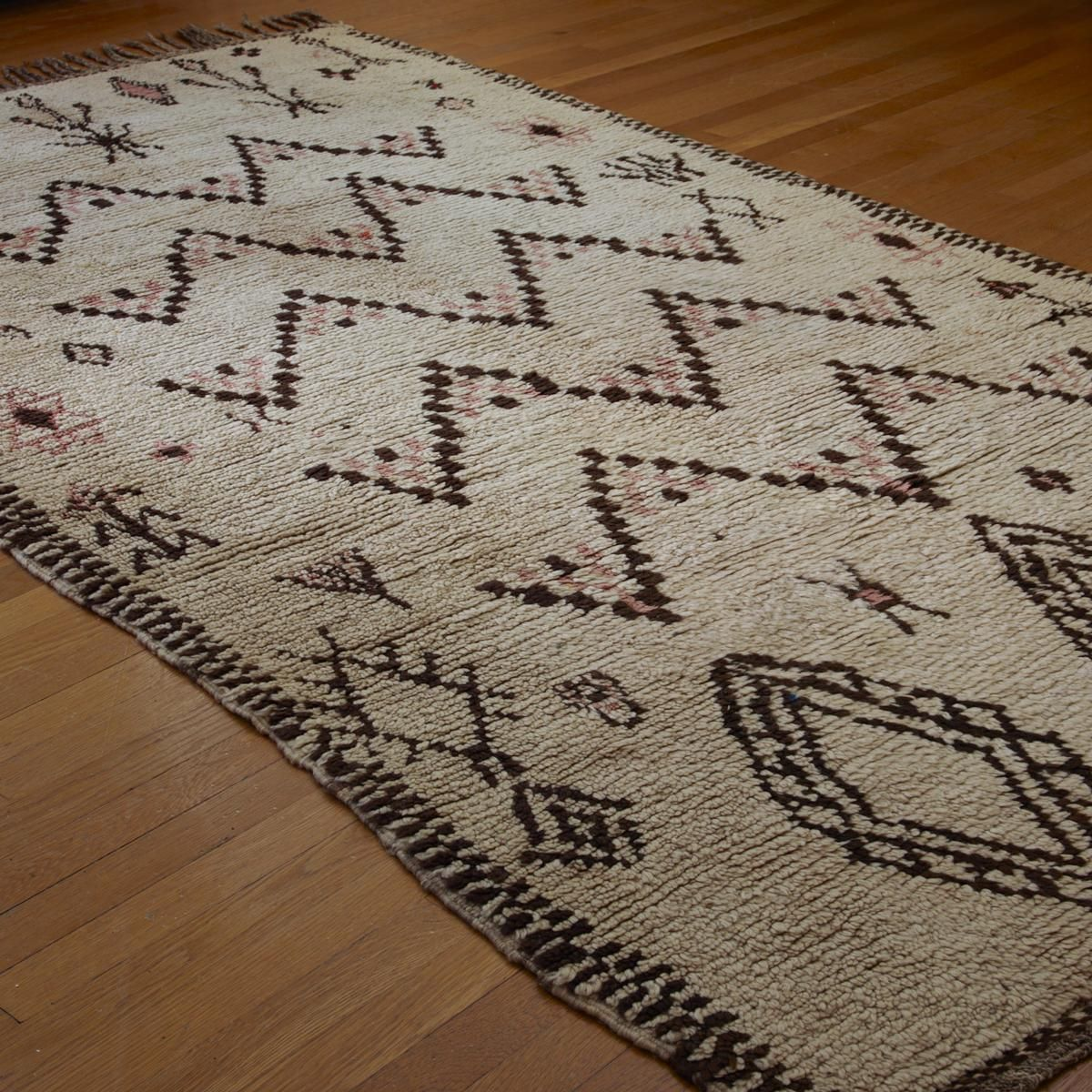 """Antique Moroccan Azilal Rug Named for a town deep in the Atlas Mountains of Morocco, the thick pile on this beautiful antique Moroccan rug is luxuriously soft and relaxing. With a touch of pink accenting cream and chocolate, this rug softly grounds any decor. (5'x9'2"""")"""