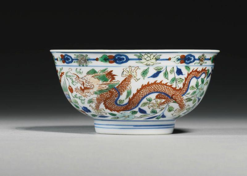 A fine wucai 'Dragon and Phoenix' bowl, Kangxi mark and period