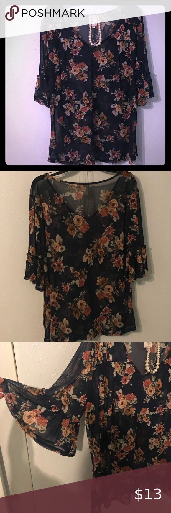 ??Very pretty floral, sheer blouse! ?? Sheer blouse! Navy with floral print. Has 3/4 bell sleeves. Very light weight and comfortable top! …