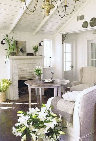white brick fireplace with comfy chairs and round table
