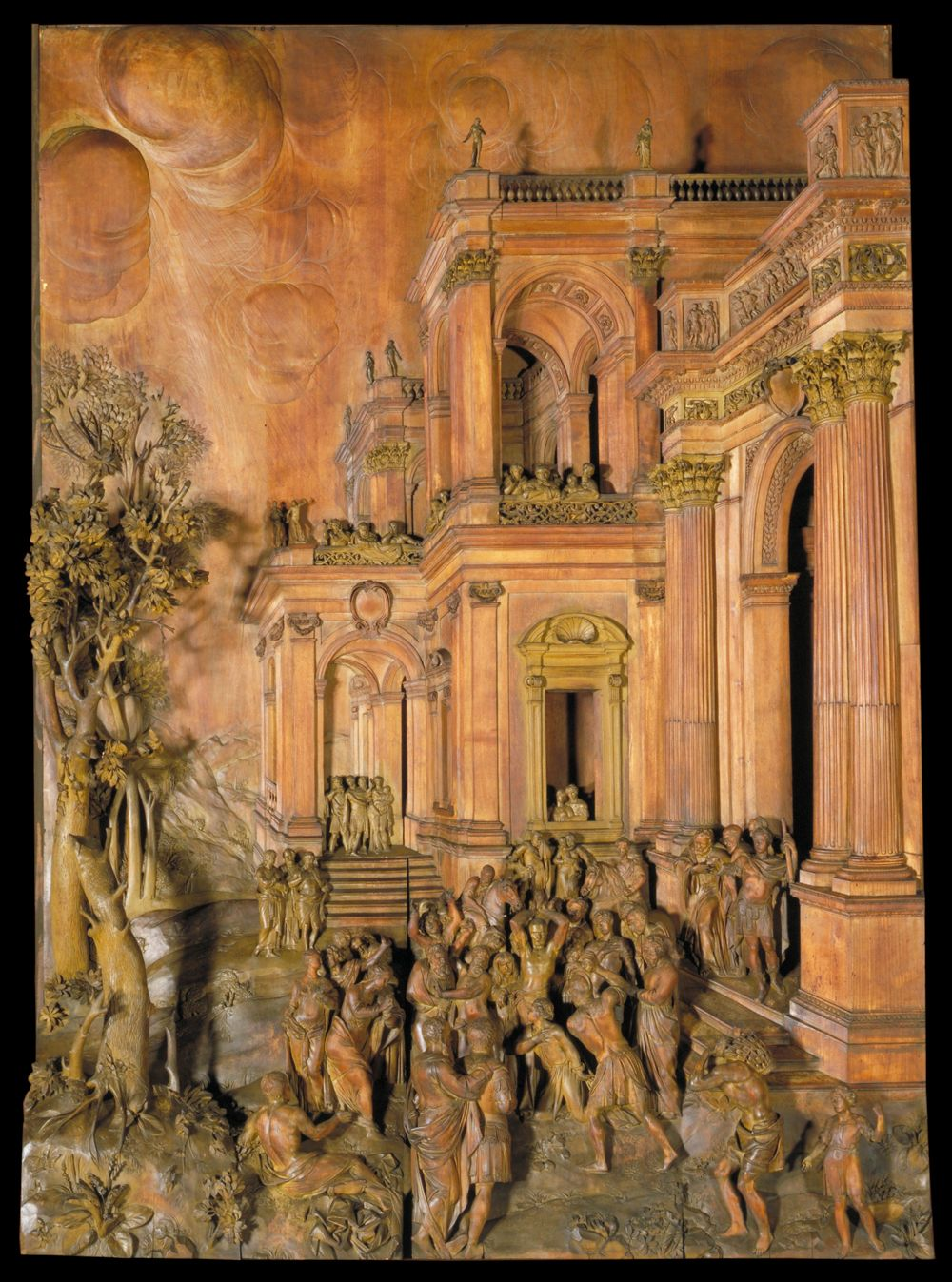 The Stoning of St Stephen - Woodcarving by Grinling Gibbons about 1680-1710.  Carved limewood and lancewood relief, with later paint Museum no. 446-1898