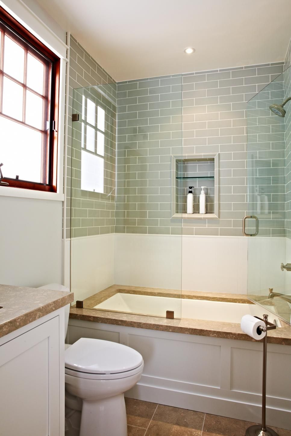 This bathroom off the guest bedroom pairs clean white tile ...