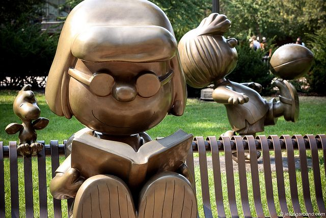 Marcie reading in Rice Park, St. Paul, MN.  Charles Schulz, the creator of Peanuts, was born and raised in St. Paul.