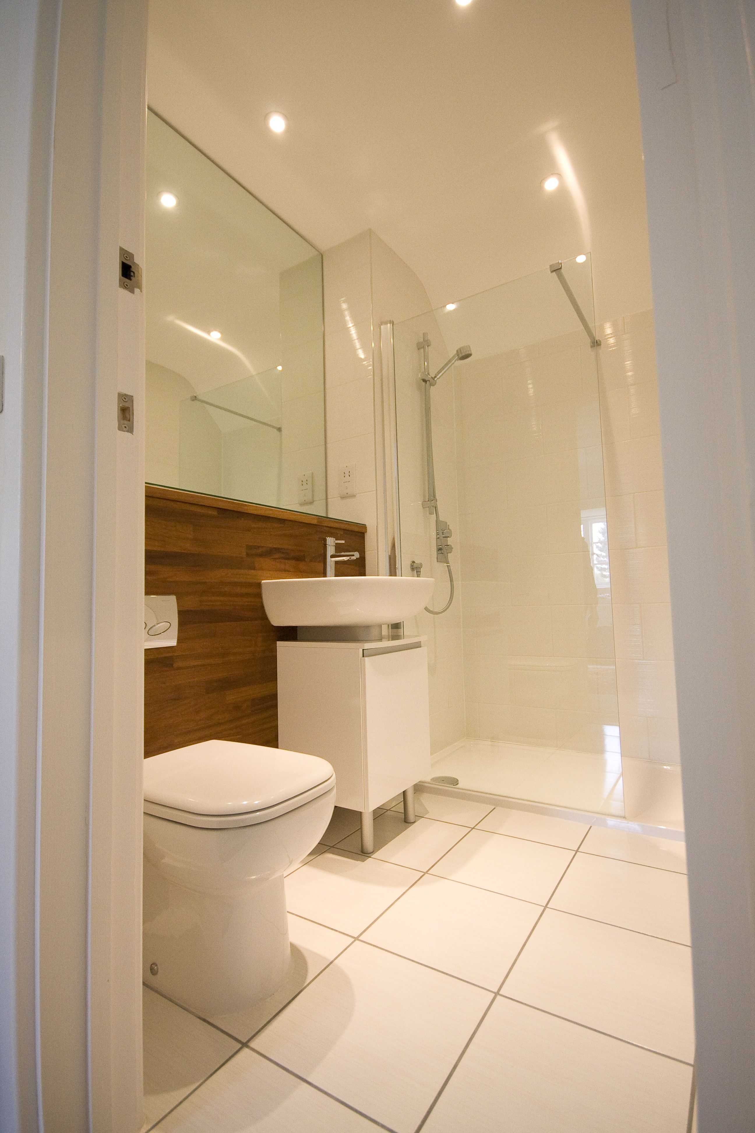 Bright white large tiles with timber and glazing white tile house ...