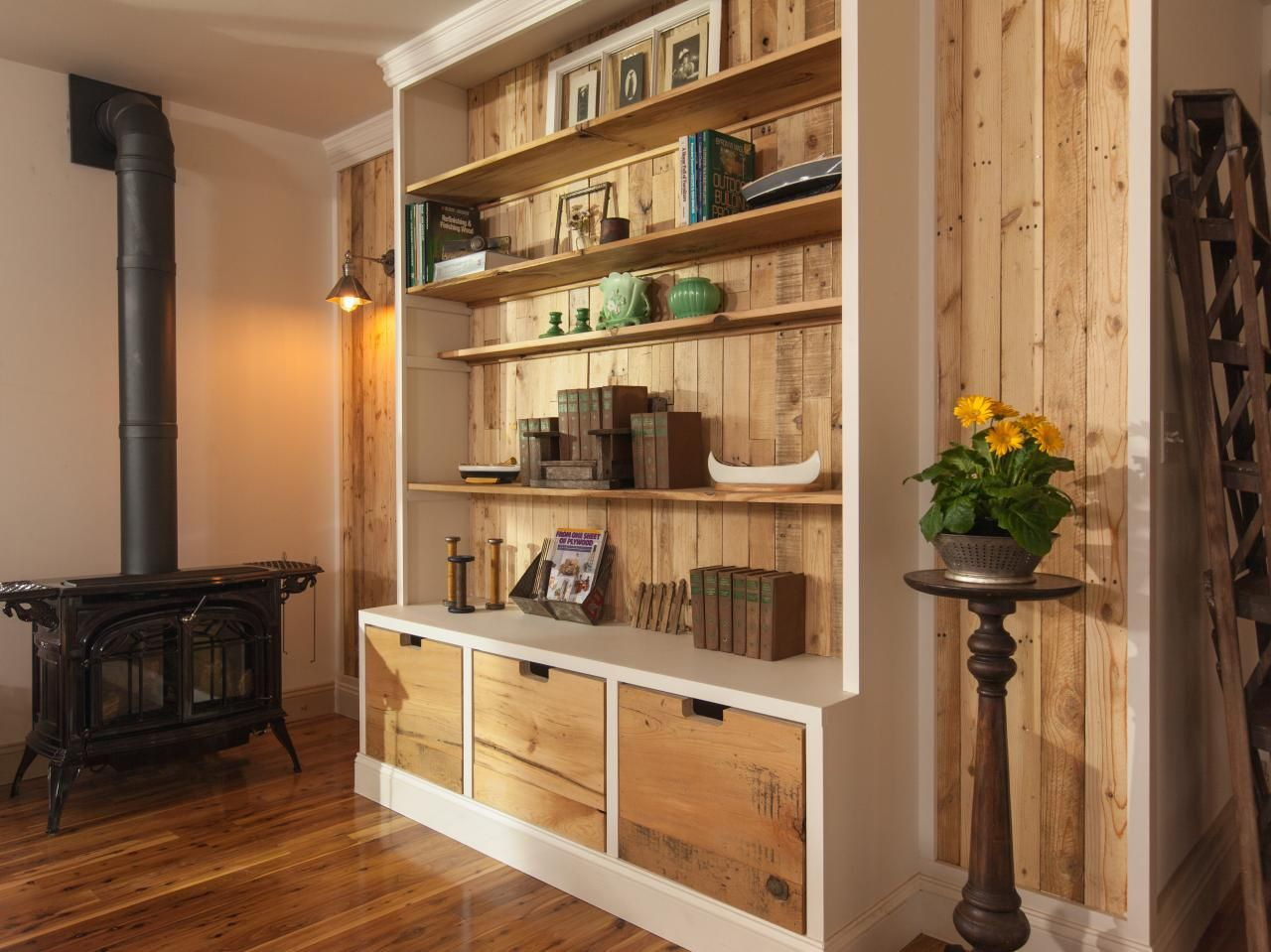 Reclaimed Wood From A Delivery Pallet Forms The Back Wall Of A Custom Crafted Library Shiplap Pl Farm House Living Room Cabin Living Room Living Room Pictures