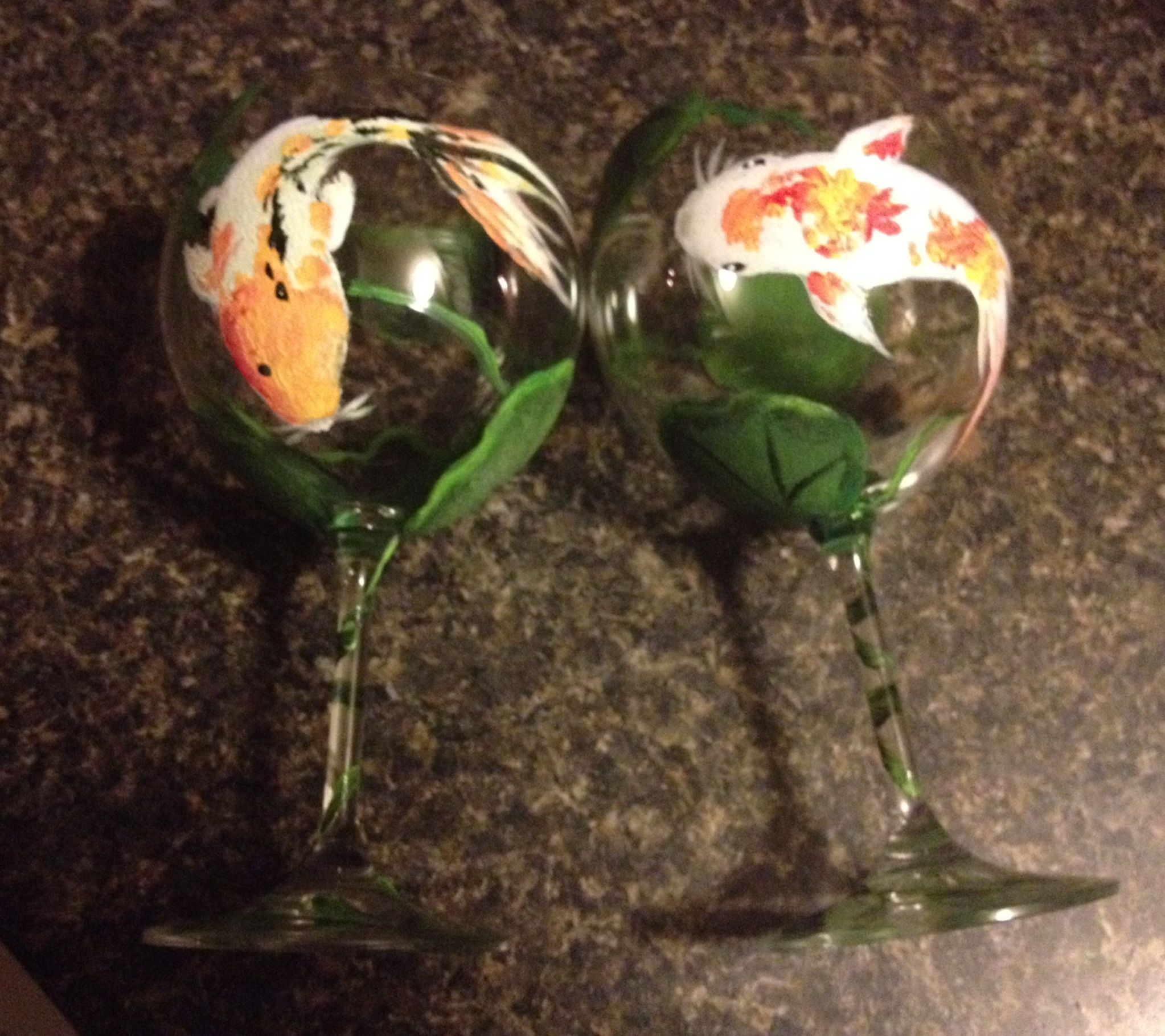 These are my favorite wine glasses I have painted to date.  These are a pair of koi fish hand painted on wine glasses - there are lily pads around the glass and the stem wraps around each stem and there are leaves along the base.  Asking $30 for the pair plus shipping