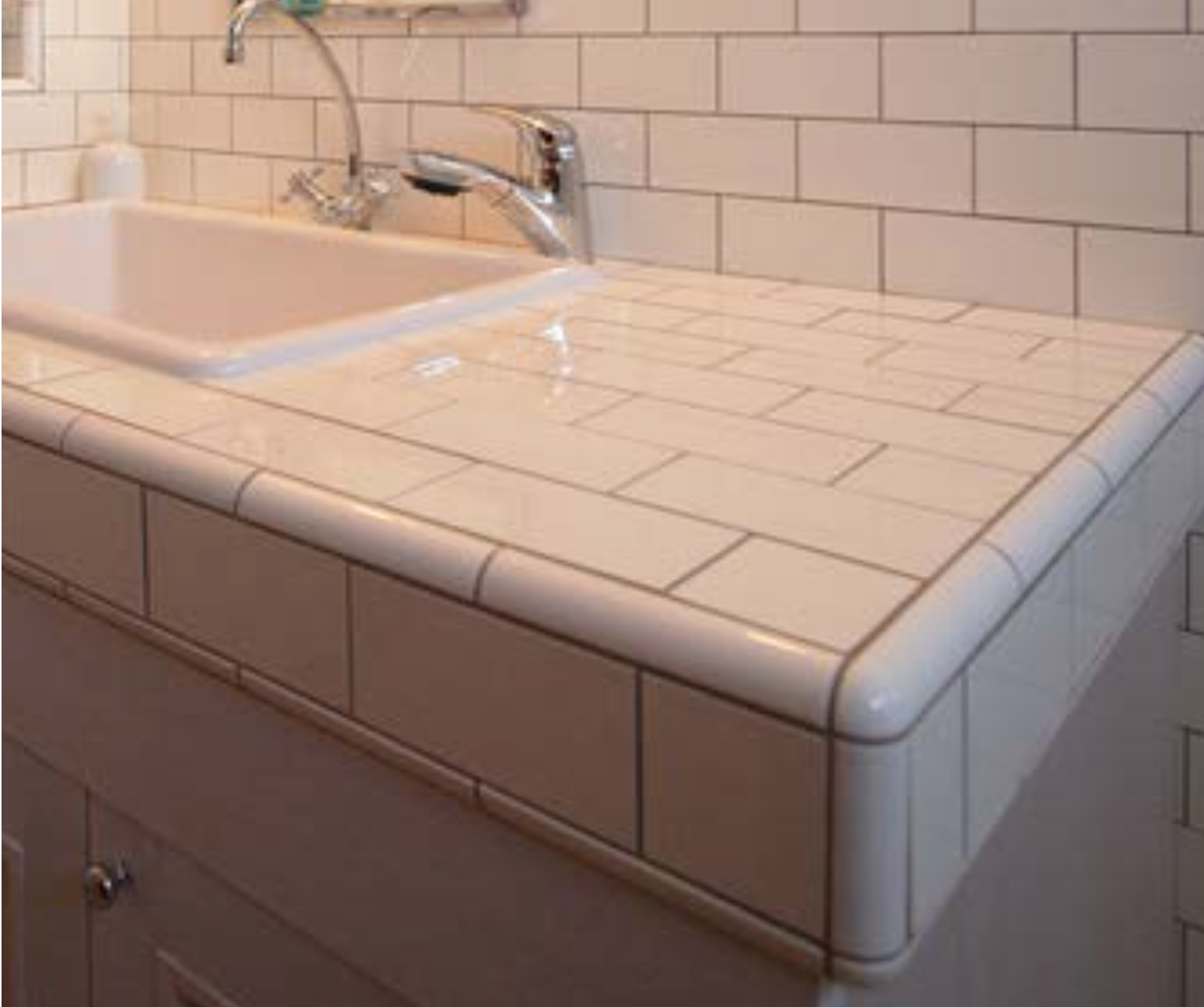 subway tile counter trimmed with