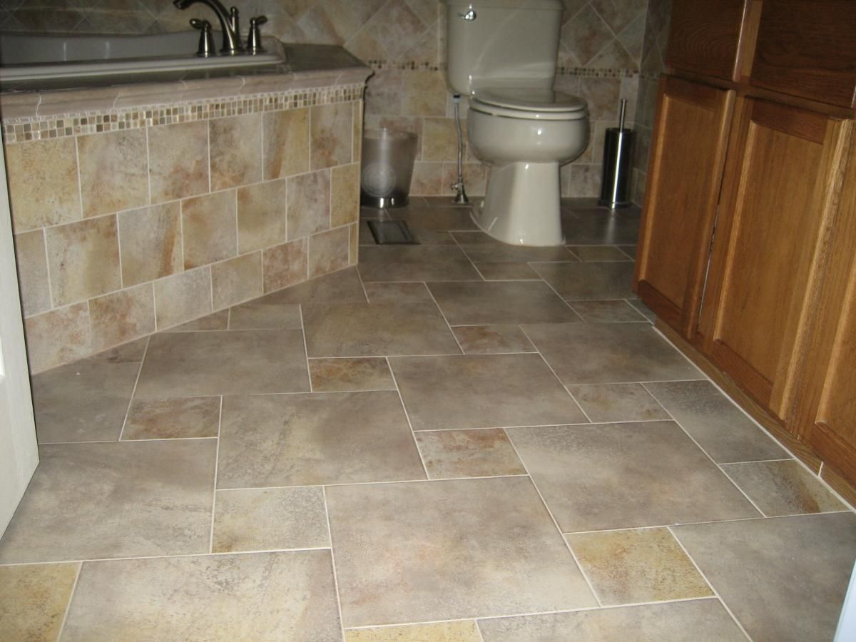How To Design Bathroom Tile Layout - Completed porcelain tile floor with a pinwheel pattern layout bathroom tile designsbathroom
