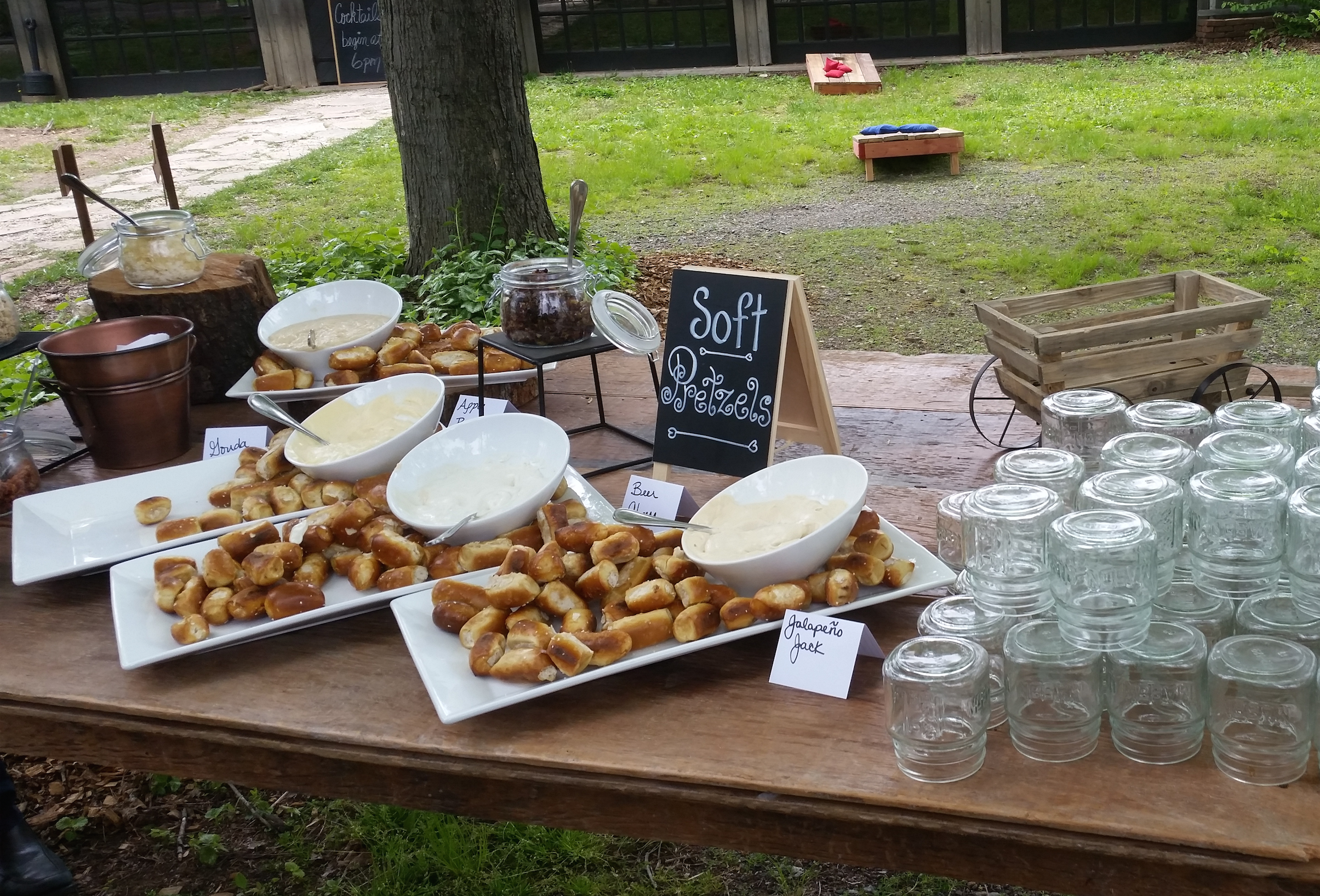 Warm Soft Pretzel Station - with the works!  Melted local Artisan cheeses, bacon bits, rock candy... #pretzelstation