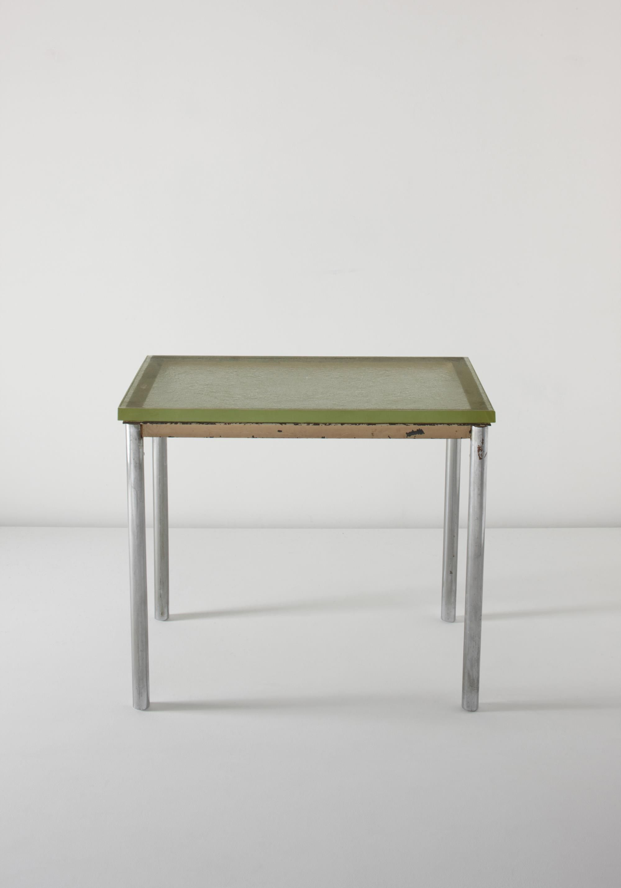 """LE CORBUSIER, PIERRE JEANNERET AND CHARLOTTE PERRIAND Rare table, model no. B307, ca. 1930  Frosted glass, chrome-plated tubular metal, painted metal. 28 5/8 x 32 1/2 x 18 7/8 in. (72.8 x 82.8 x 47.8 cm.) Manufactured by Thonet Frères, France; glass manufactured by Saint-Gobain, France. One leg with manufacturer's metal label with logo and """"Thonet."""""""