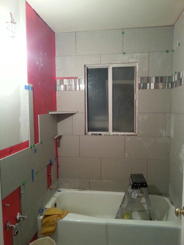Bathroom progress 1 The tiling is coming along great! Our friend AJ