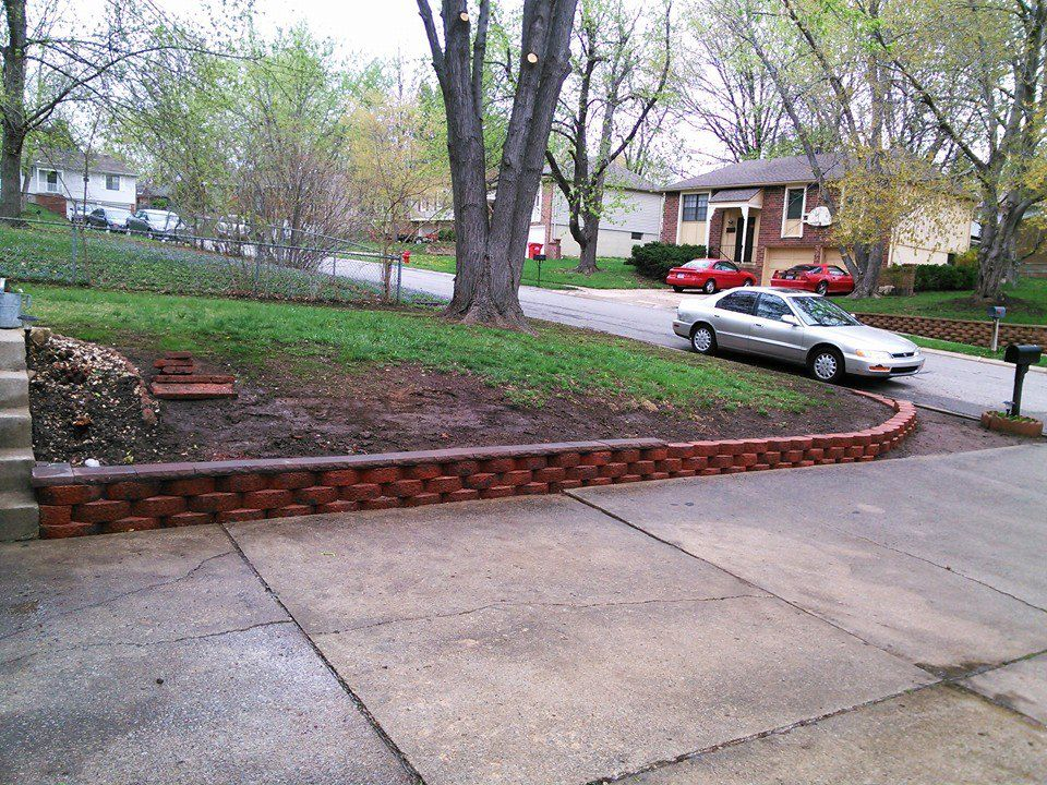 Creating A Low Profile Retaining Wall Against The Edge Of Driveway