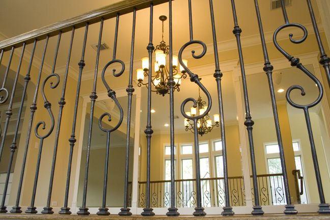 This Staircase Uses High Quality Wrought Iron Balusters To Create