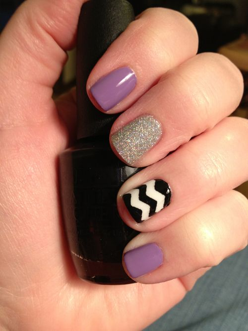 Current manicure. OPI Do You Lilac It, My Boyfriend Scales Walls, and Black Onyx. The glitter nail is China Glaze Glistening Snow. I did the chevron using masking tape and craft scissors. I'm so happy with the results!!!