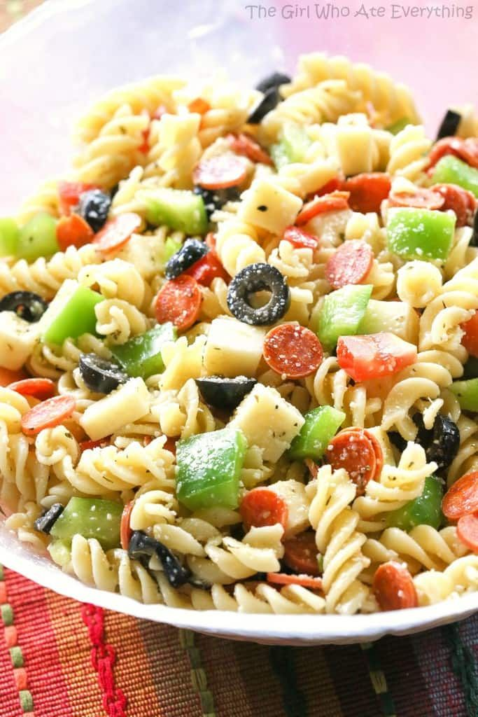 Pizza Pasta Salad has all the flavors of a delicious pizza in a pasta salad Mini pepperonis olives green bell pepper cubes of cheese tomato  all tossed in a vinaigre...
