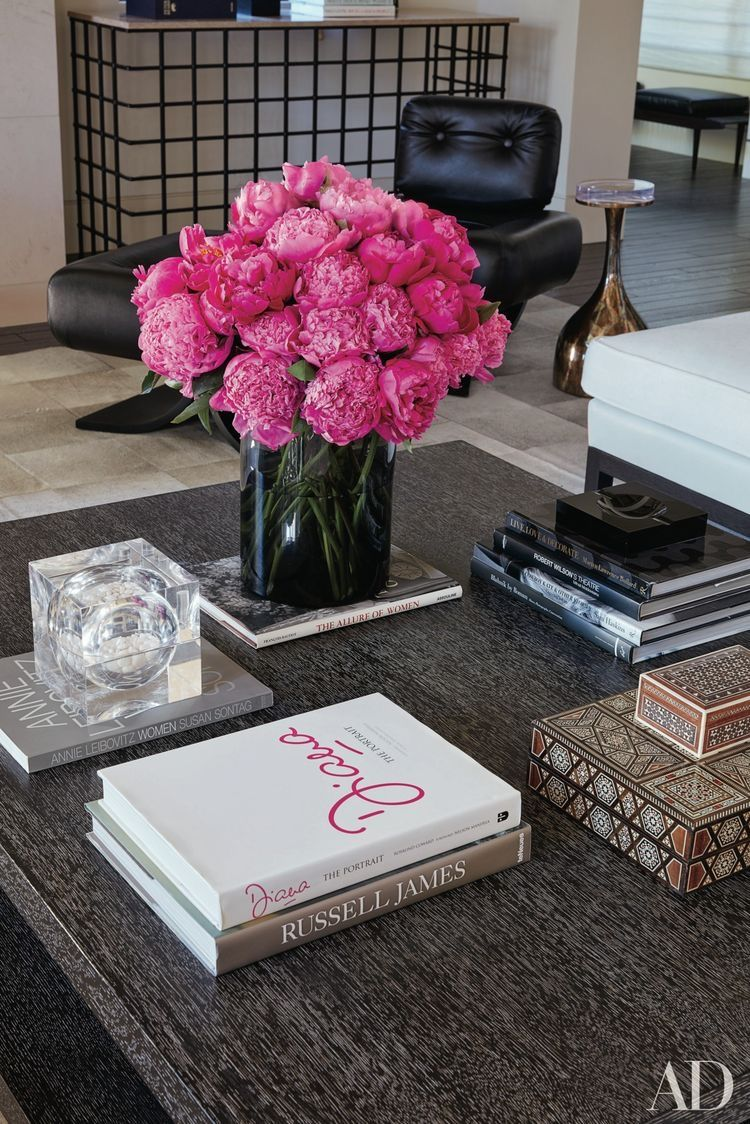 Hot pink floral arrangement takes center stage on this coffee table
