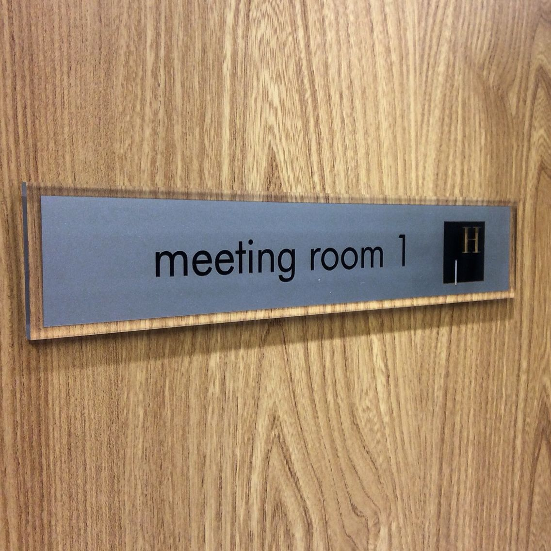 the sign on the door is a de-signage office door sign smart signs