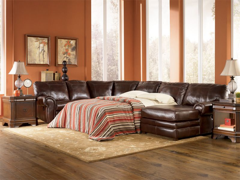 Sofa Tables Signature Design by Ashley Merrion Mahogany Leather Sectional with Sleeper Sofa