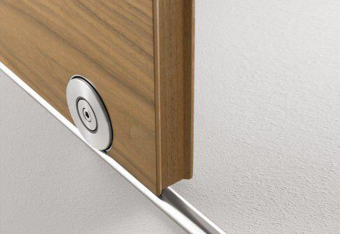 Image from https://karmatrendz.files.wordpress.com/2009/01/wooden-sliding-door-2.jpg.