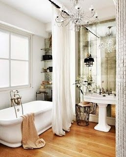 love that the curtain comes from the ceiling.