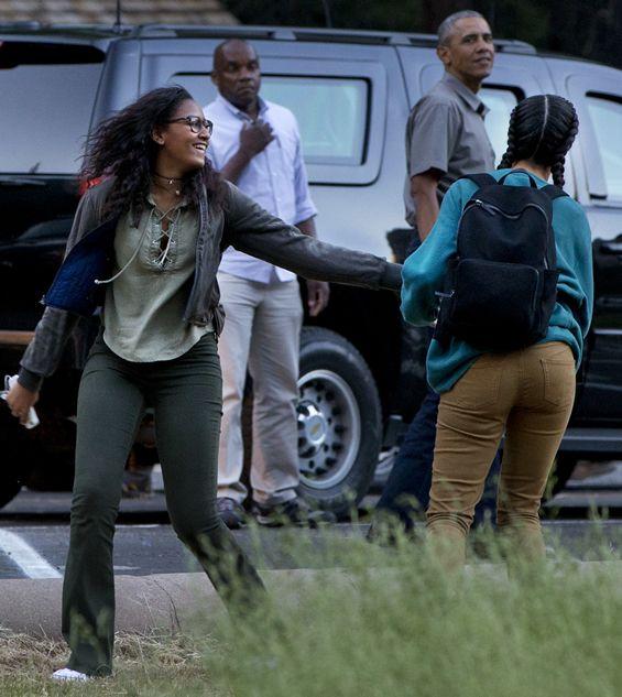 President Barack Obama Looks On As Sasha Jokes With Sister Malia