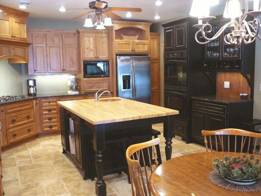 rustic cherry cabinets with black island | Rustic cherry ...