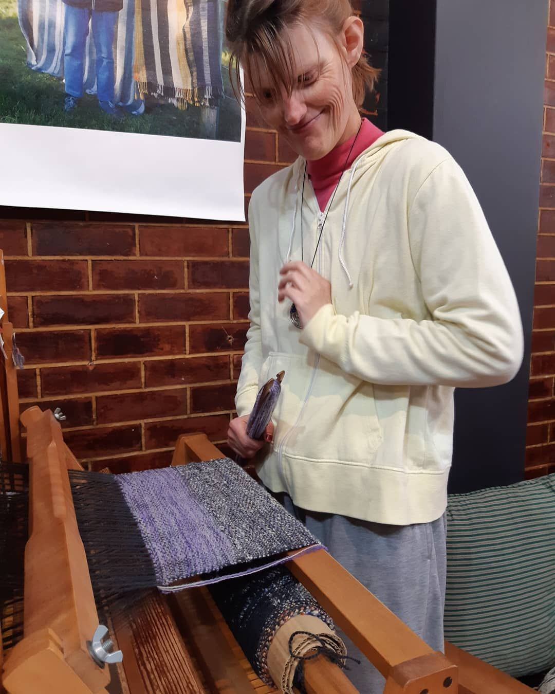 Productive day in the Rose Weavery. Tania is showing us her work, both the weaving of it and a finished piece from last year.  #taniasweaving #hohepaweaving  #handmade #nzmade #woolen #weaving #localcraftsmanship #weaversofinstagram #localtalent #crafts #creative #handwovenscarf #