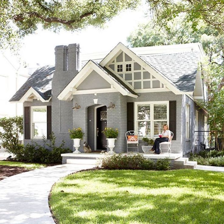 High Quality Gray Painted Brick Cottage With White Trim.