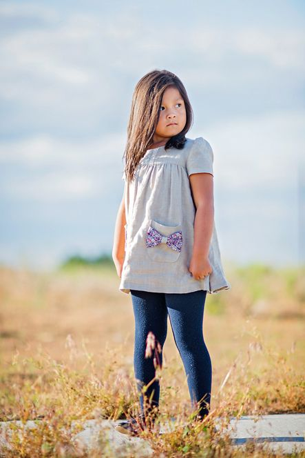 The Ania tunic is a swingy tunic designed for an active child. The tunic comes with two sleeve length options and a simple closure in the back. A swingy gathered bodice and bow shaped pockets add a feminine touch. The tunic can be made in woven and knit fabric. It pairs perfectly with our Wild and Free lounge pants. The Ania Tunic is available in sizes 9-12month through 12 years.This is a confident beginner friendly pattern.The PDF tutorial includes:Computer generate... #tunicdesigns