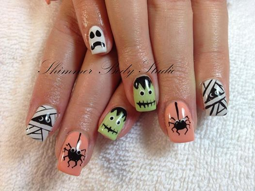 Photo: Our first Halloween nails!  A mix of creepy characters for Michelle :)  Gel nails, gel paint, Halloween nails, spider, frankenstein, mummy, ghost nails by Shimmer Body Studio.
