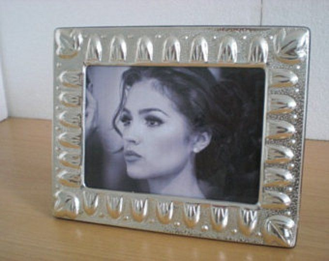 The Sterling silver Frame is an outstanding gift that could be giving in different occasions such as Mother's Day, Christmas, Birthdays, Weddings, anniversary and for any special occasion.