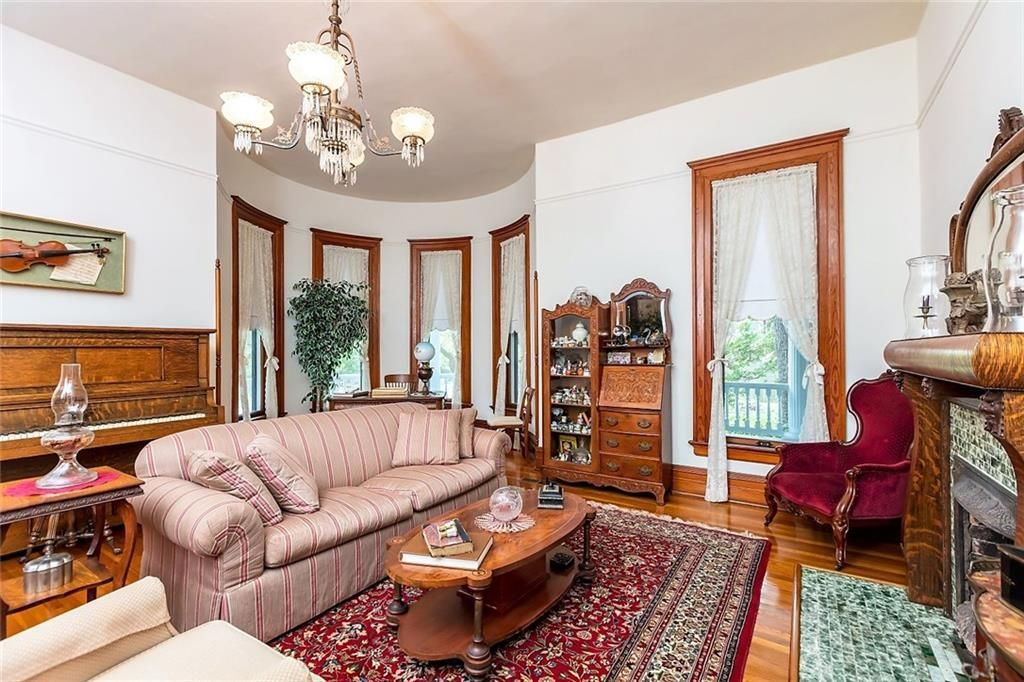 Classic Queen Anne Style Victorian Home Sitting Parlor Room With Turret Rounded Sitting Nook Luxury Homes Interior Sitting Nook House Interior Queen anne living room ideas