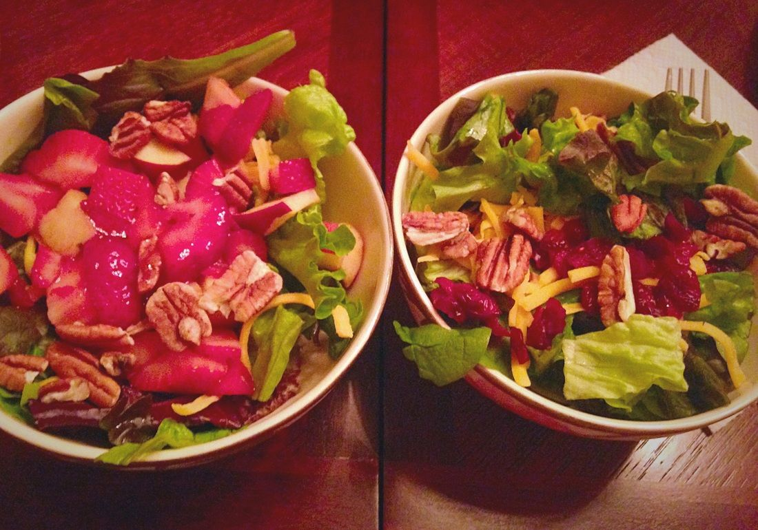 Sweet salads with strawberries, dried cranberries, pecans, and raspberry vinaigrette