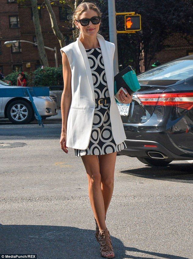 51947e62381 So chic  The socialite donned a 60 s inspired mini dress with a white vest  as she was seen out during the Mercedes-Benz Fashion Week in New York City  on ...