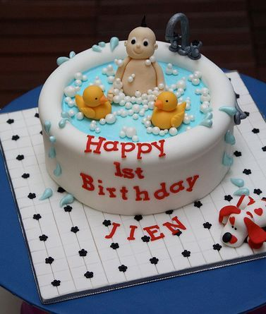 images of cute first birthday cake with baby in tub and rubber