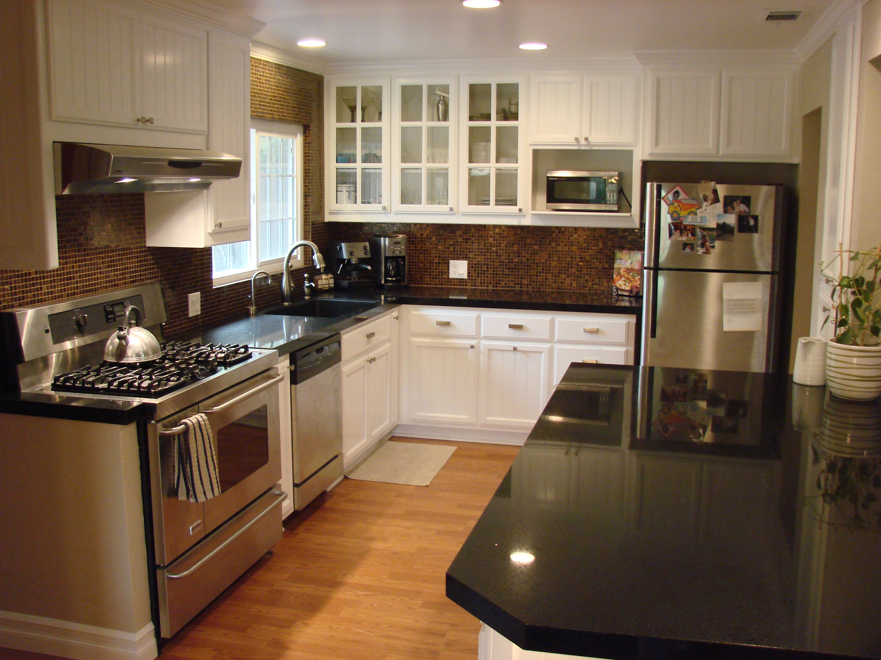 Kitchen Remodel Featuring New Granite Counter Tops And Mosaic