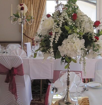 Centerpiece floral centerpiece on silver stands to hire wedding floral top on silver stands to hire x all about weddings venue decoration ceremony decoration silk bouquets wedding hire and wedding accessories junglespirit Choice Image