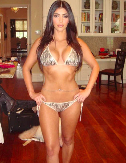 2f8c98342a Here s a Teenage Kim Kardashian Wearing a Gold Bikini and a Belly Chain  -Cosmopolitan.com