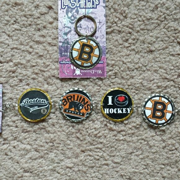 """Handmade bottlecap Boston Bruins bracelet BUNDLE Bottle cap keychain and bracelet set. Bracelet is 8 """" long.  Handmade from upcycled bottlecaps. Each bottlecap is flattened by hand, hole punched and sealed.  Imperfections are normal and only add to the authenticity and unique value of a handmade piece. Price is firm, a unique handmade piece not found in stores! If you are only interested in one piece in this bundle I can make a separate listing. Accessories"""