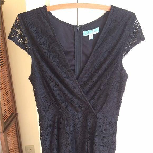 Black lace romper Black lace romper with shorts; v-neck neckline; back zipper; cap sleeve; Francesca's size medium Francesca's Collections Pants Jumpsuits & Rompers