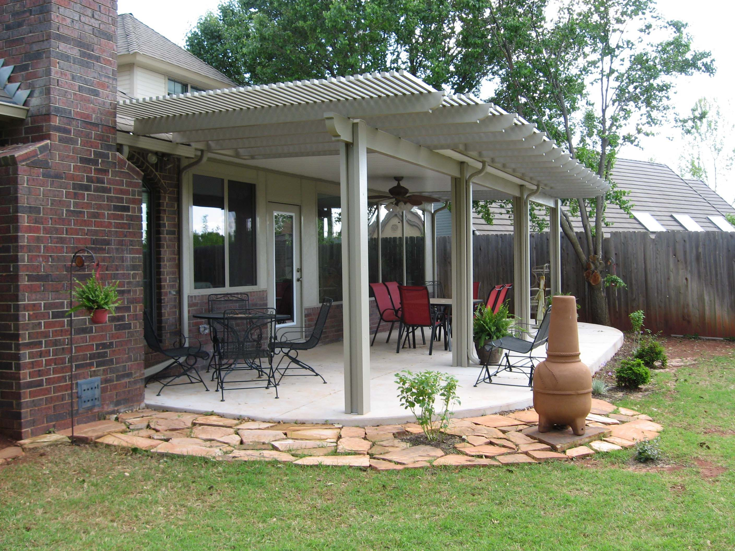 Relax under a patio cover or arbor in oklahoma city for Best backyard patio designs