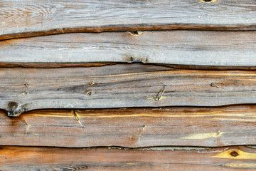 Fragment of old brown wooden fence.