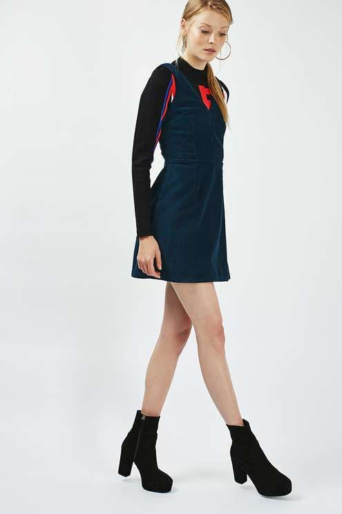 2992060f607 Take it back to the '90s in this super-cool denim mini dress. We love the V  neckline and dark indigo hue. Wear with a crossover bag and black sliders  for an ...