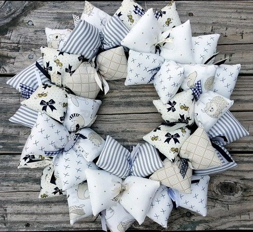 Just like a lot of wedding color themes being black and white nowadays, baby's nurseries have a lot of contrast in them.  This gentle and charming baby's room wreath has that kind of contrast that you