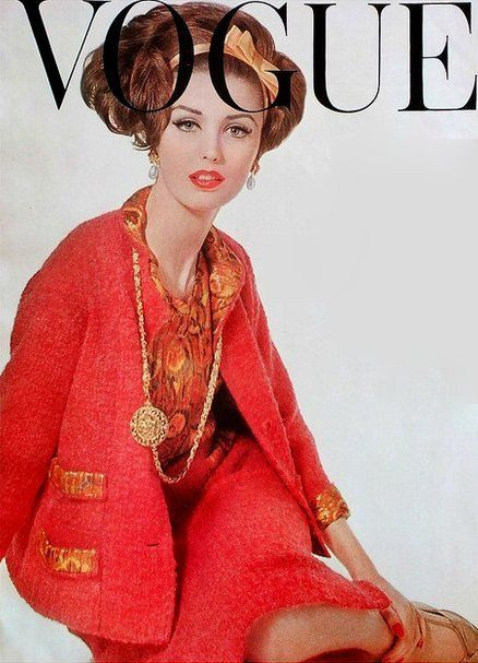1961 Dorothea McGowan in coral wool_mohair boucle suit trimmed in orange and gold Lurex same as the blouse, by Chanel