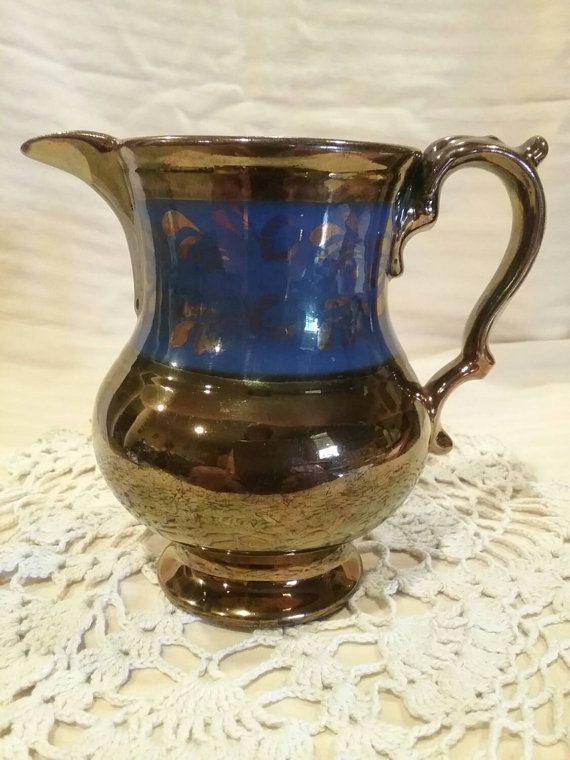 Check out this item in my Etsy shop https://www.etsy.com/listing/239513596/antique-pottery-pitcher