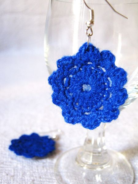A pair of blue crocheted earrings.    A pair of red crocheted earrings. $9.00